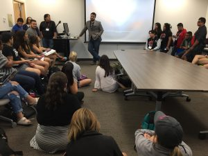 Gary Cooper speaks to a full room about how he went from a child in Del Rio, to a Texas State Bobcat, to a multimedia journalist at Univision. Photo by Alison Bryce