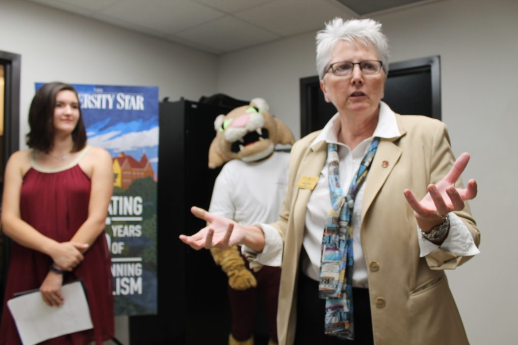 Judy Oskam, director of the School of Journalism and Mass Communication, speaks to students and staff at the Student Media open house Thursday morning.