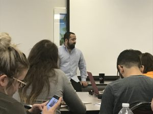 Justin Johnson speaks to students during Texas State's annual Mass Comm Week about how networking has benefited him and how it can benefit others. Photo by Jessy Garza